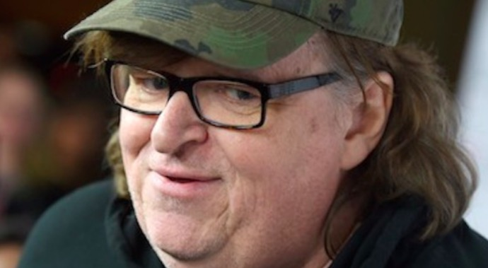 Michael Moore Tells Everyone to Wake Up and Smell the Coffee, Don't Let Trump Distract You!